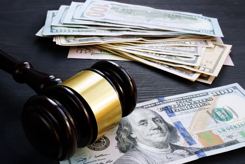 Bail bond and financial penalty. Gavel and money.